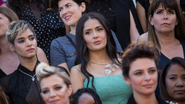 Salma Hayek calls for male to stars to get pay cut