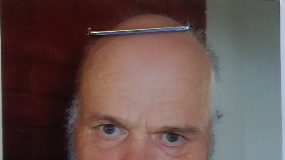 "Timothy Wells is described a white male, approximately 6'0"" and 270 lbs. He has thinning grey hair, a scruffy beard and blue eyes and was last seen wearing a blue jacket with a white crest on the left side and an orange bicycle helmet."