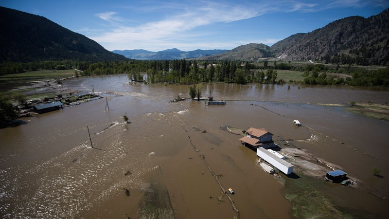 A home damaged by flood waters is seen in an aerial view, near the Kettle River in Grand Forks, B.C., on Saturday May 12, 2018. (THE CANADIAN PRESS/Darryl Dyck)
