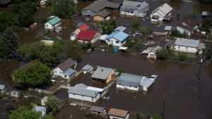 A flooded area of Grand Forks, B.C., is seen in an aerial view on Saturday May 12, 2018. (The Canadian Press/Darryl Dyck)