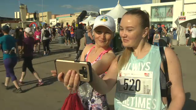 A mother and daughter pose for a selfie ahead of the 2018 Mother's Day Run, Walk and RIde at Chinook Centre on May 13, 2018