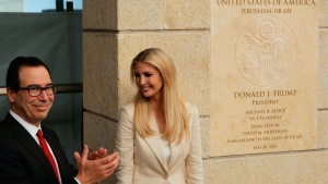 U.S. President Donald Trump's daughter Ivanka Trump, right, and U.S. Treasury Secretary Steve Mnuchin attend the opening ceremony of the new U.S. embassy in Jerusalem, Monday, May 14, 2018. Amid deadly clashes along the Israeli-Palestinian border, President Donald Trump's top aides and supporters on Monday celebrated the opening of the new U.S. Embassy in Jerusalem as a campaign promised fulfilled. (AP Photo/Sebastian Scheiner)