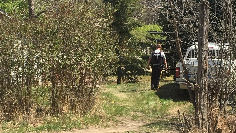 Police search a home where a man was found dead at Regina Beach on May 14, 2018 (Katy Syrota / CTV Regina)