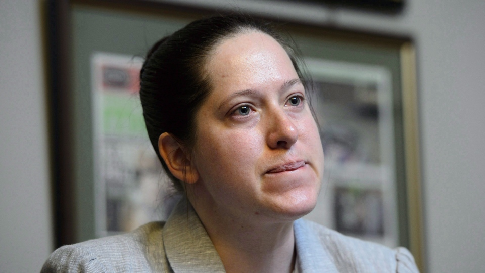 "NDP MP Christine Moore says she's taking legal action to fight a former soldier's allegations of sexual misconduct, which she describes as a ""total lie"" aimed at attacking her credibility. Moore takes part in an interview in her office in Ottawa on Friday, May 11, 2018. (THE CANADIAN PRESS/Sean Kilpatrick)"