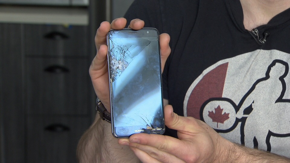 Scott Rose shows what his phone looked like after sending it away to get repaired. (CTV)