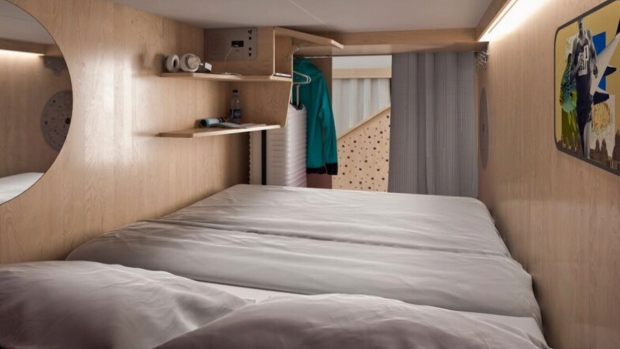 You don't get a room at the Pangea Pod Hotel, but you do get a double bed with a curtain for privacy.