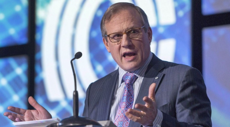 Louis Audet, chief executive of Cogeco Communications, speaks to shareholders at the company's annual meeting Wednesday, January 13, 2016 in Montreal. Louis Audet is stepping aside as president and CEO of the Cogeco cable and broadcasting companies founded by his family, and will be replaced by Philippe Jette on Sept. 1. (THE CANADIAN PRESS/Ryan Remiorz)