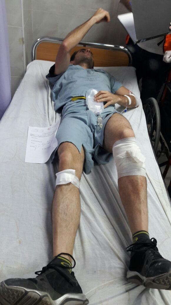 This image shows Dr. Tarek Loubani being treated for a gunshot wound on his leg on May 14, 2018. (Dr. Tarek Loubani / Medium.com)