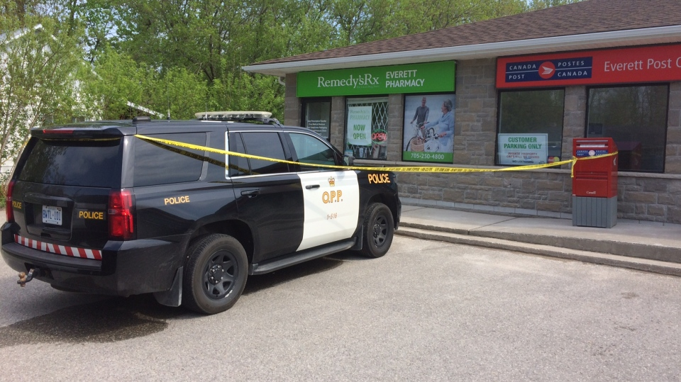 Police stand hold the scene at a pharmacy robbed in Everett on Tuesday May 15, 2018. (CTV Barrie)