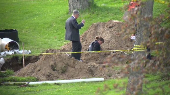 Police investigate the discovery of possible human remains at a property on Riverbank Drive in Cambridge on Monday, May 15, 2018.