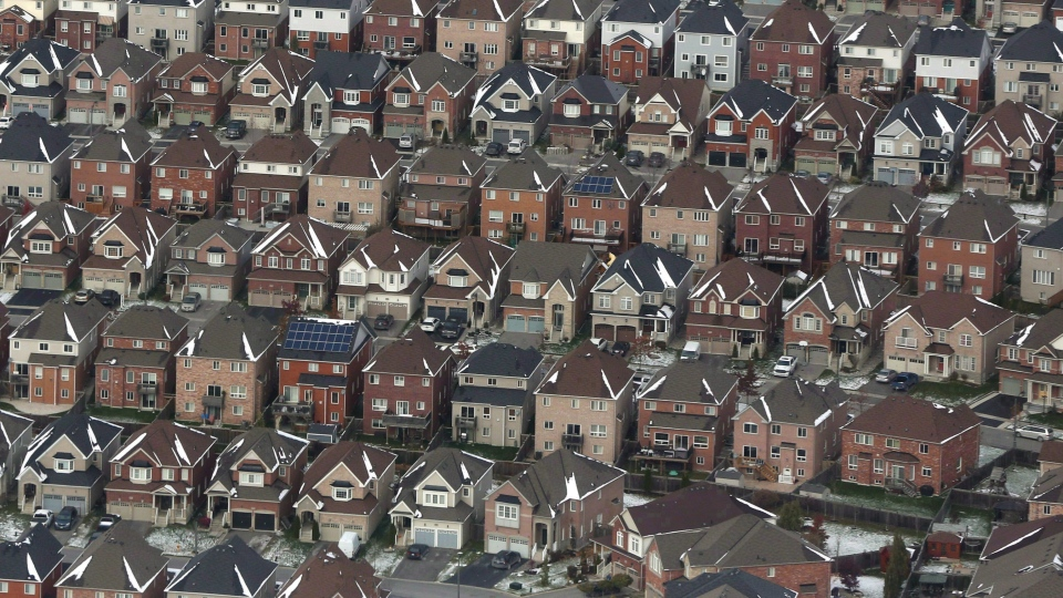 Aerial view of houses in Oshawa, Ont., seen from a Canadian forces Hercules on Saturday, Nov. 11, 2017. (THE CANADIAN PRESS/Lars Hagberg)
