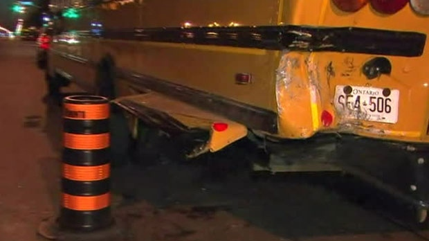 One man is dead and a driver is facing charges after a vehicle crashed into a parked school bus in Etobicoke.