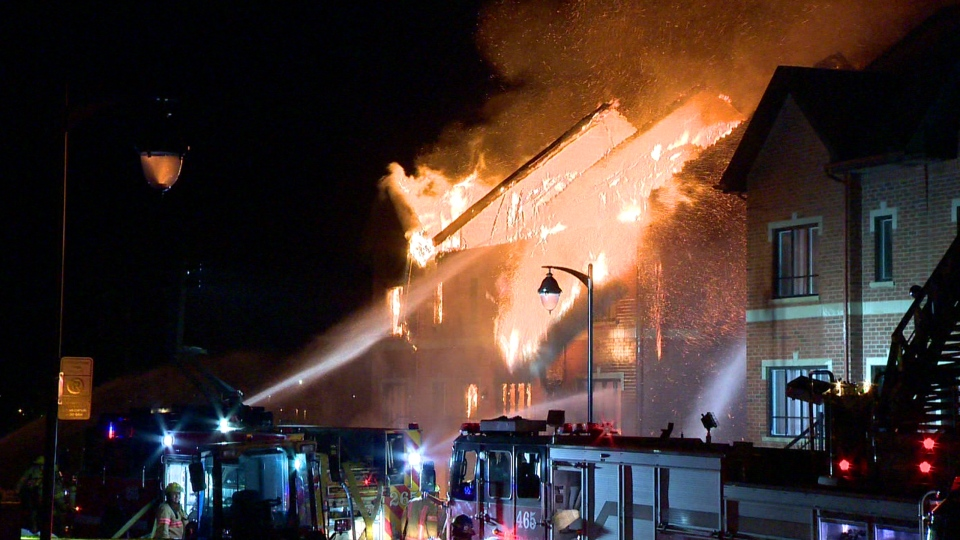 Firefighters battled a five-alarm fire on Bois des Caryers St. in LaSalle, Montreal (CTV Montreal/Cosmo Santamaria)