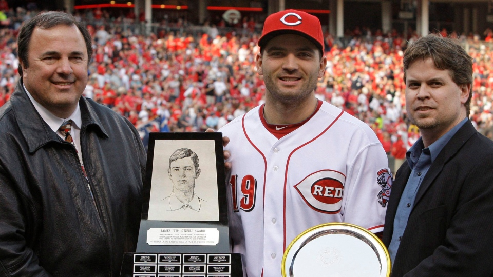 Cincinnati Reds first baseman Joey Votto (19) is awarded the 2010 Tip O'Neill Award for being named the best Canadian baseball player by Tom Valcke, president of the Canadian Baseball Hall of fame, left, and Scott Crawford, vice-president of the CBHOF, during ceremonies prior to a major league baseball game against the Florida Marlins, Saturday, April 30, 2011 in Cincinnati. THE CANADIAN PRESS/AP-Al Behrman