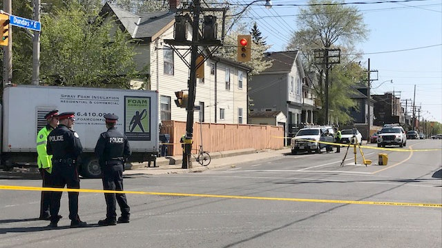 Toronto police investigate a crash in Leslieville where a cyclist was fatally struck by a truck on May 16, 2018.