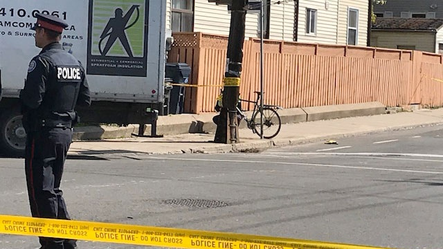 Police say a male cyclist died after being struck by a truck in Leslieville on May 16, 2018.
