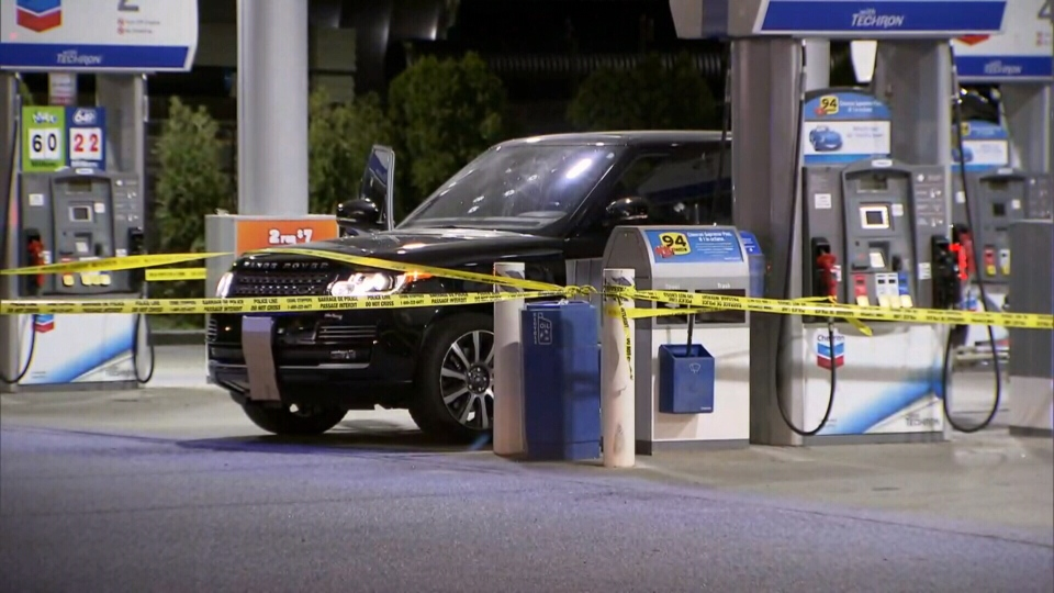 Police tape surrounds a Chevron gas station in Langley, B.C. after a shooting that left one man dead. May 15, 2018.
