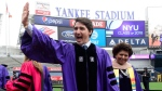 Prime Minister Justin Trudeau takes part in the procession prior to delivering the commencement address to New York University graduates at Yankee Stadium in New York on Wednesday, May 16, 2018. THE CANADIAN PRESS/Sean Kilpatrick