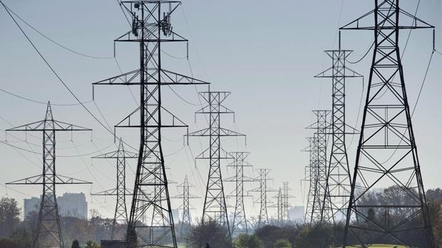 Hydro towers are seen over a golf course in Toronto on Wednesday, November 4, 2015.Hydro One says its first-quarter profit rose to $222 million, which was up 33 per cent from the same time last year. THE CANADIAN PRESS/Darren Calabrese