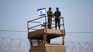 In this Tuesday, May 15, 2018 file photo, Israeli soldiers guard on top of a watch tower in a community along the Israel- Gaza Strip Border. (AP Photo/Ariel Schalit, File)