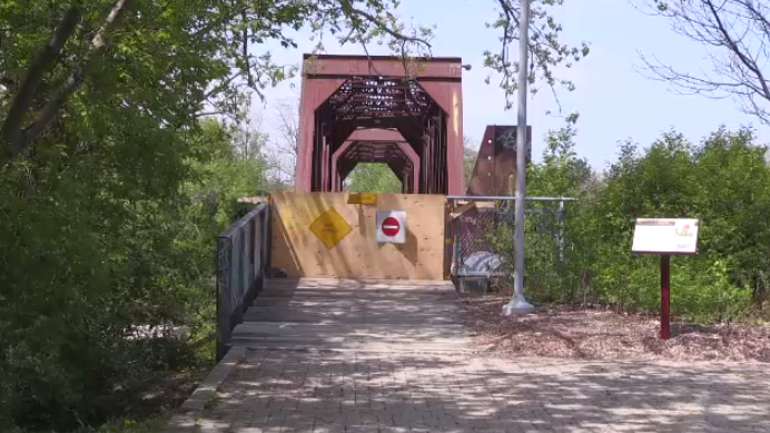 The Brant's Crossing pedestrian bridge will remain closed through the summer, city officials say.