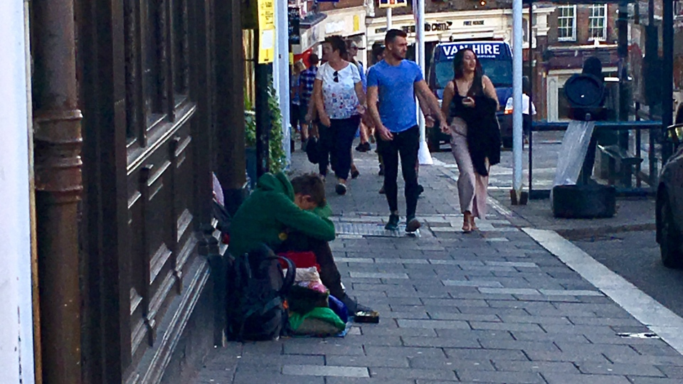 A homeless person on the streets of Windsor, England, which is gearing up for the wedding between Prince Harry and Meghan Markle, on Wednesday, May 16, 2018. (Jill Macyshon / CTV News)
