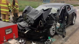 In this Friday, May 11, 2018, file photo released by the South Jordan Police Department shows a traffic collision involving a Tesla Model S sedan with a Fire Department mechanic truck stopped at a red light in South Jordan, Utah. (South Jordan Police Department via AP, File)
