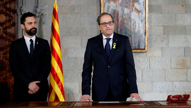 FILE - Catalan President Quim Torra, right, talks during a swearing in ceremony next to Catalan Parliament President Roger Torrent at the Catalonia's Parliament in Barcelona, Thursday, May 17, 2018. (Alberto Estevez, Pool via AP)