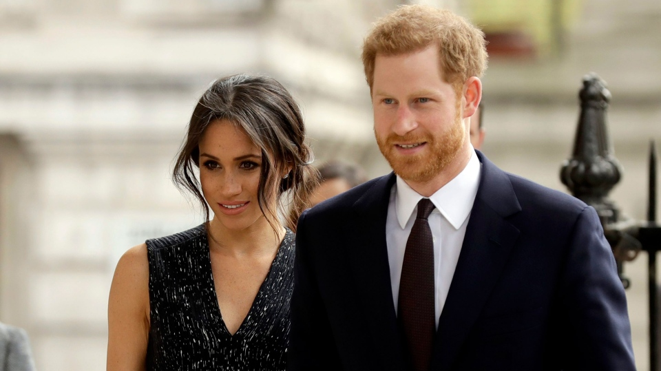 In this Monday, April 23, 2018 file photo, Britain's Prince Harry and his fiancee Meghan Markle arrive to attend a Memorial Service to commemorate the 25th anniversary of the murder of black teenager Stephen Lawrence at St Martin-in-the-Fields church in London.  (AP Photo/Matt Dunham, file)