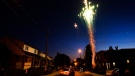 Residents light fireworks along their street during the Victoria Day long weekend in Toronto on Monday, May 24, 2010. (Nathan Denette / THE CANADIAN PRESS)