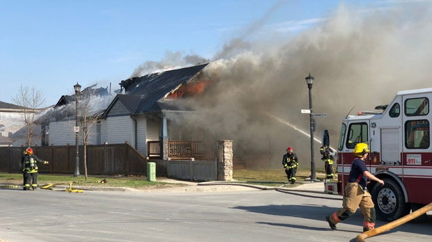 Firefighters battle the fire that broke out Wednesday, May 17.