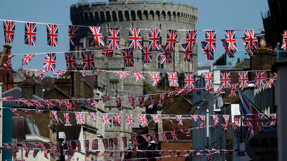 Union Jack flags fly across the main shopping street in Windsor, Tuesday, May 15, 2018.  THE CANADIAN PRESS/AP/Frank Augstein