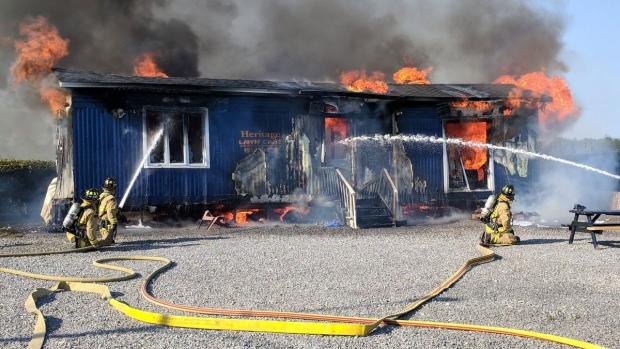 Firefighters battle trailer fire in Manotick