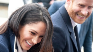 In this file photo dated Thursday March 8, 2018, Britain's Prince Harry and his fiancee Meghan Markle arrive for an event for young women, as part of International Women's Day in Birmingham, central England. THE CANADIAN PRESS/AP/Rui Vieira, FILE
