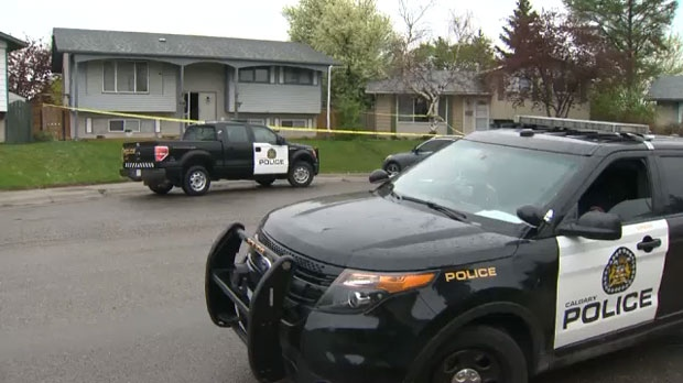 CPS units outside of a home on Penbrooke Close S.E. following an investigation into reports of a break-and-enter and the fatal shooting of one person at the hands of police.