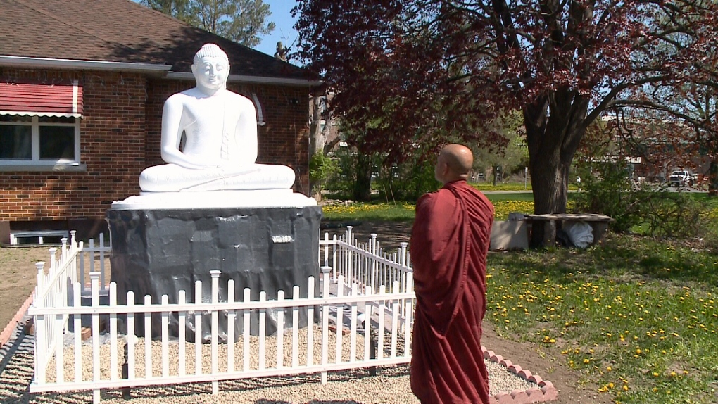 Buddha statue in front of Heron Road Temple.