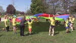 Goderich's Friendship games.  pic of kids with a parachute