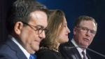 In this file image, Foreign Affairs Minister Chrystia Freeland and Mexico's Secretary of Economy Ildefonso Guajardo Villarrea look on as United States Trade Representative Robert Lighthizer delivers his statements to the media during the sixth round of negotiations for a new North American Free Trade Agreement in Montreal, Monday, January 29, 2018. (THE CANADIAN PRESS/Graham Hughes)