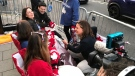 CTV News Chief Anchor and Senior Editor Lisa LaFlamme talks to Canadians camping out along the royal wedding procession route in Windsor, U.K. on Thursday, May 17, 2018. (Rosa Hwang / CTV News)
