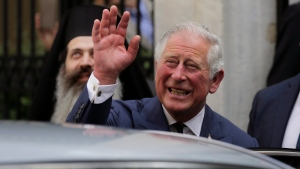 In this Thursday, May 10, 2018 file photo, Prince Charles, waves as he leaves a meeting with the head of Greece's Orthodox Church Archbishop Ieronymos, in Athens. (AP Photo/Petros Giannakouris)