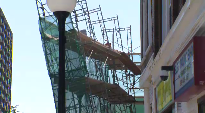A truck nearly brought down scaffolding set up in front of a building on Queen Street in Kitchener.