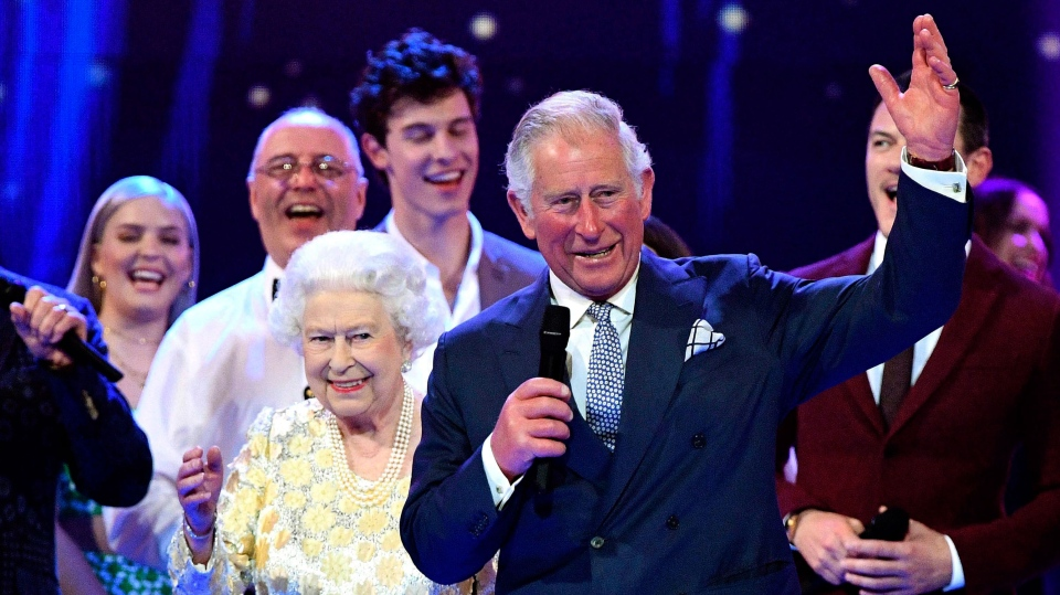 Queen Elizabeth II and the Prince Charles stand with performers on stage at at the Royal Albert Hall in London on Saturday April 21, 2018, for a concert to celebrate the 92nd birthday of Britain's Queen Elizabeth II. (Andrew Parsons/Pool via AP)