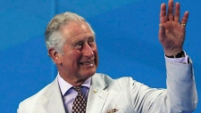 Prince Charles waves to the crowd as he waits to present medals at the Aquatic Centre during the 2018 Commonwealth Games on the Gold Coast, Australia, Thursday, April 5, 2018. (AP Photo/Rick Rycroft)