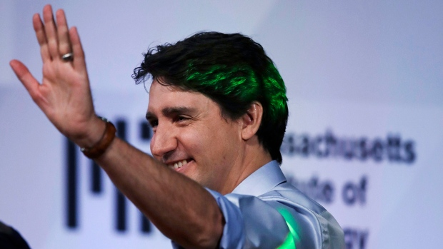Prime Minister Justin Trudeau waves to the audience as he is introduced during the Massachusetts Institute of Technology's Solve conference at MIT in Cambridge, Mass., Friday, May 18, 2018. (AP Photo/Charles Krupa)