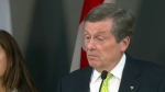 Toronto Mayor John Tory speaks to reporters at city hall about a surge of refugees in the city's housing shelter system on May 18, 2018.