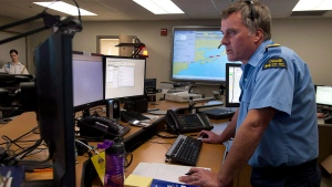 A Canadian Coast Guard officer works at the Joint Rescue Coordination Centre in Halifax on May 2, 2013. (THE CANADIAN PRESS/Andrew Vaughan)