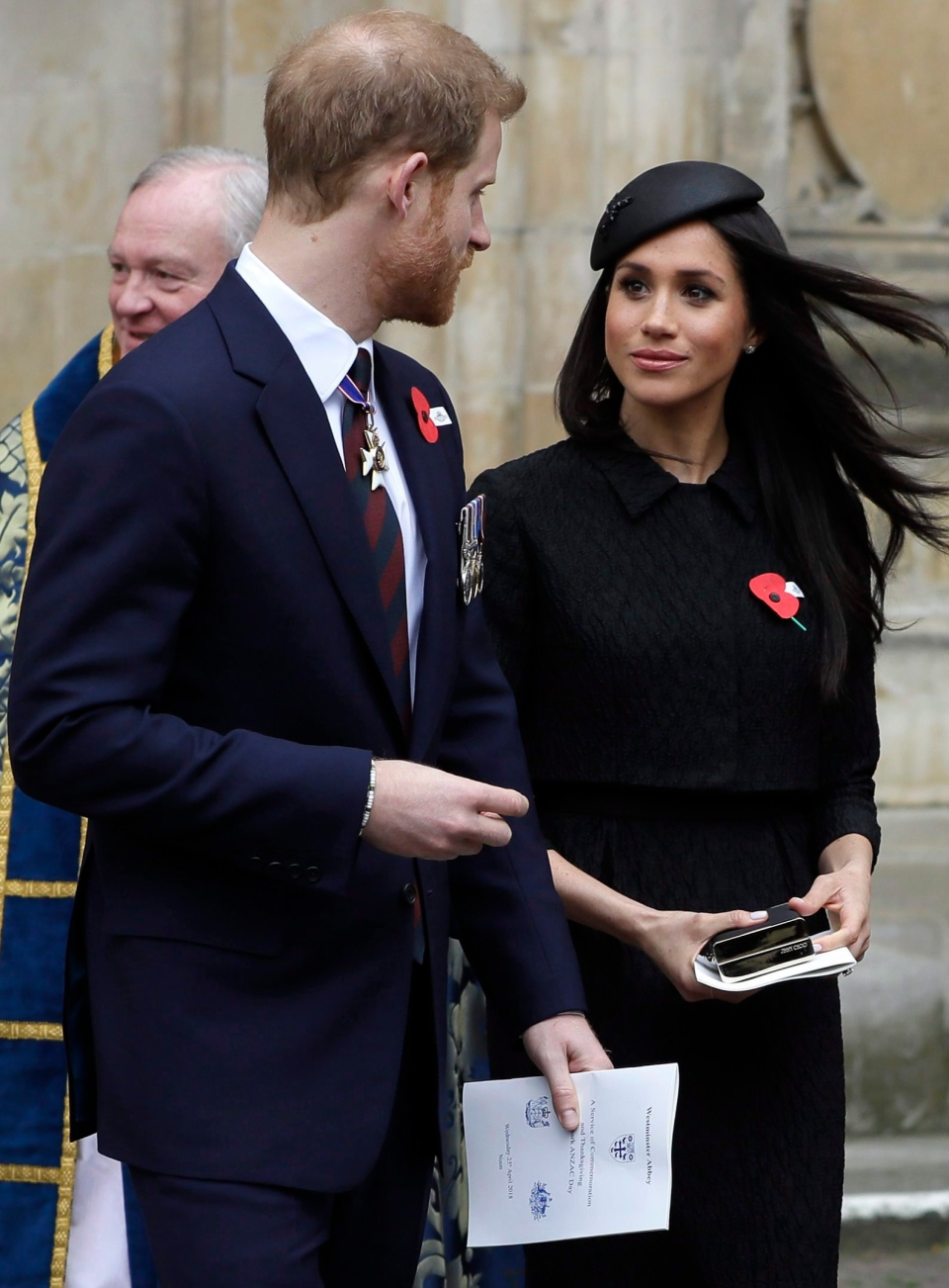 Britain's Prince Harry and Meghan Markle leave after attending a Service of Thanksgiving and Commemoration on ANZAC Day at Westminster Abbey in London, Wednesday, April 25, 2018. (AP Photo/Kirsty Wigglesworth)