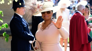 Oprah Winfrey waves as she arrives at St George's Chapel at Windsor Castle the wedding ceremony of Prince Harry and Meghan Markle at St. George's Chapel in Windsor Castle in Windsor, near London, England, Saturday, May 19, 2018. (Ian West / pool photo via AP)
