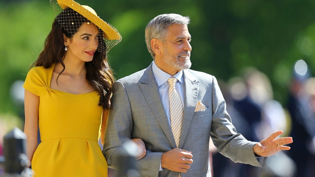 9db06b23fd7 Amal Clooney and George Clooney arrive for the wedding ceremony of Prince  Harry and Meghan Markle at St. George s Chapel in Windsor Castle in  Windsor