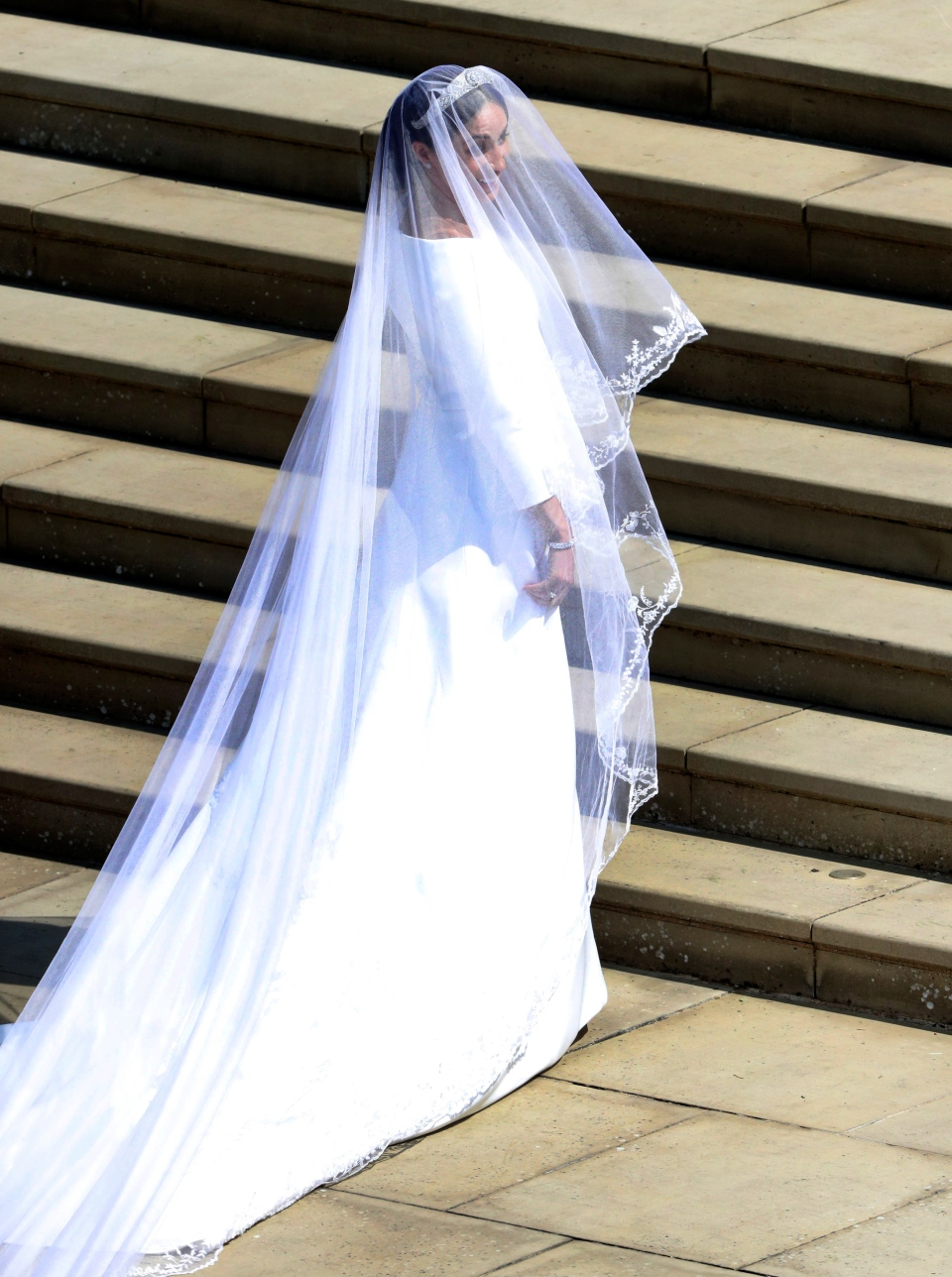 Meghan Markle arrives for the wedding ceremony of Prince Harry and Meghan Markle at St. George's Chapel in Windsor Castle in Windsor, near London, England, Saturday, May 19, 2018. (Andrew Matthews/pool photo via AP)